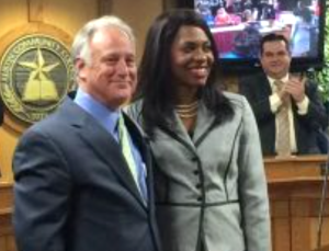 Gigi Edwards Bryant with State Senator Kirk Watson at the swearing in ceremony for new ACC board members (Photo courtesy of Senator Watson)